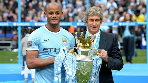 Manuel Pellegrini, right, insists he has no issues with his captain Vincent Kompany