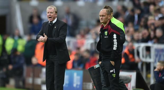 Norwich manager Alex Neil (right) was less than impressed by his side's 6-2 defeat at Newcastle.