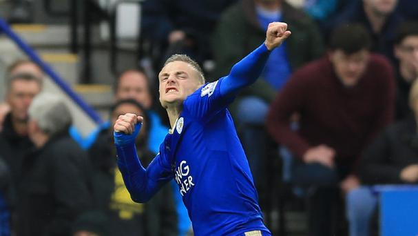 Jamie Vardy celebrates scoring for the seventh successive Premier League game in a row