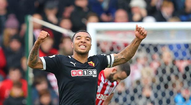 Troy Deeney put Watford ahead just before half-time at Stoke.