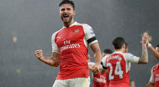 Olivier Giroud helped Arsenal to the top of the Premier League