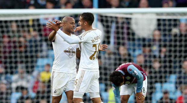 Swansea's Andre Ayew (left) celebrates with Kyle Naughton after scoring the winner in Saturday's 2-1 victory at Aston Villa.