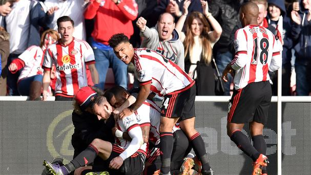 Sunderland's Steven Fletcher is mobbed by team-mates after scoring in the 3-0 win over Newcastle.