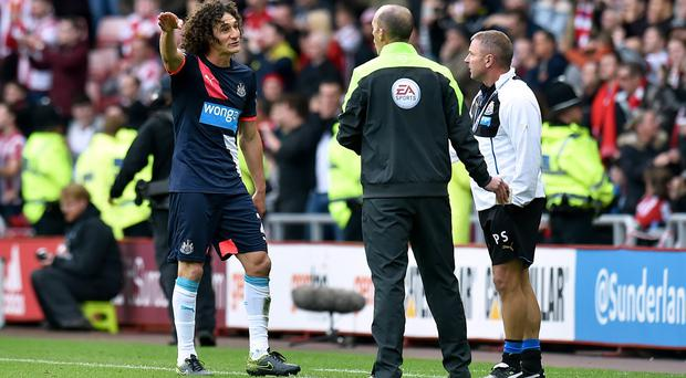 Fabricio Coloccini remonstrates with the fourth official following his red card against Sunderland
