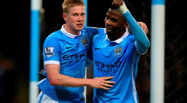 Goal bonus: Manchester City's Kevin De Bruyne (left) celebrates with team-mate Kelechi Iheanacho after the second goal