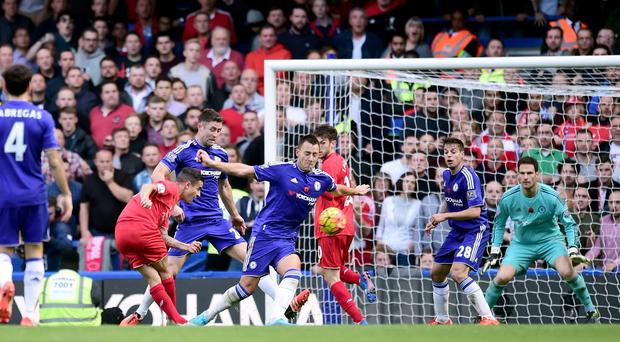 Philippe Coutinho, left, scored a brace as Liverpool beat Chelsea 3-1