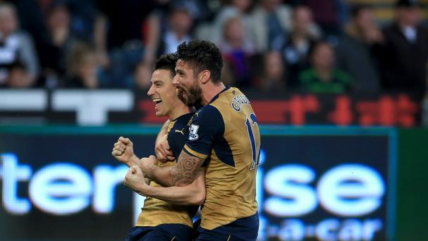 Laurent Koscielny (left) celebrates scoring Arsenal's controversial second goal with Olivier Giroud in their 3-0 win at Swansea.