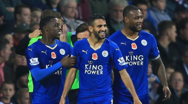 Riyad Mahrez, pictured centre, wants Leicester to continue the way they are going