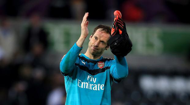 Goalkeeper Petr Cech's hunger is driving Arsenal on this season, says Gunners defenders Per Mertesacker.