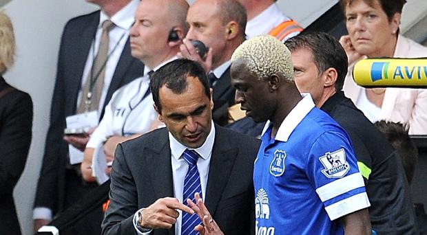 Everton manager Roberto Martinez, left, has never lost faith in Arouna Kone