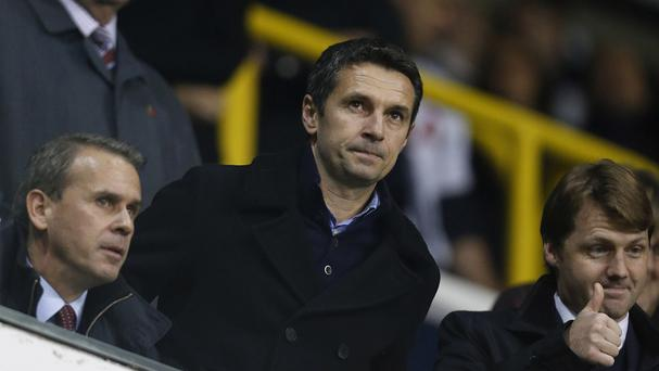 Remi Garde, centre, watched his new side lose at Tottenham on Monday night
