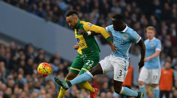 Norwich's Nathan Redmond battles for the ball with Manchester City's Bacary Sagna