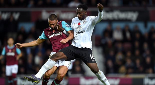 Everton goalscorer Romelu Lukaku, right, battles for possession with Winston Reid