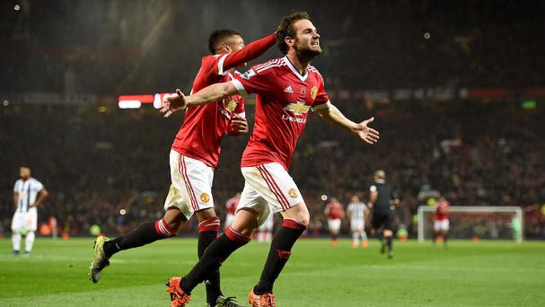 Juan Mata, right, celebrates making sure of the points at Old Trafford