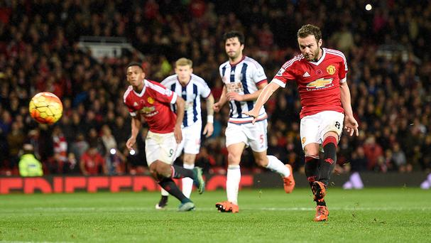Juan Mata, right, was on target from the penalty spot as Manchester United beat West Brom