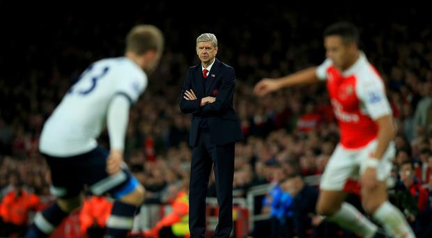 Arsenal manager Arsene Wenger, centre, praised the way his side battled to a 1-1 draw with Tottenham