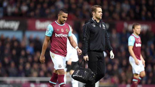 Dimitri Payet (left) limped out of West Ham's draw with Everton on Saturday