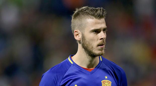 David De Gea, pictured, worked with Quique Sanchez Flores while the two were with Atletico Madrid