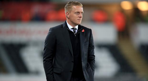 Swansea manager Garry Monk has called on his players to show their unity against Bournemouth to arrest a dramatic slump in form.