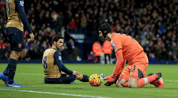 Arsenal's Mikel Arteta (centre) and Petr Cech hold an inquest after West Brom's winner.