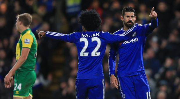 Chelsea's Diego Costa (right) celebrates scoring his side's first goal of the game with Willian (centre) during the Barclays Premier League match at Stamford Bridge, London.