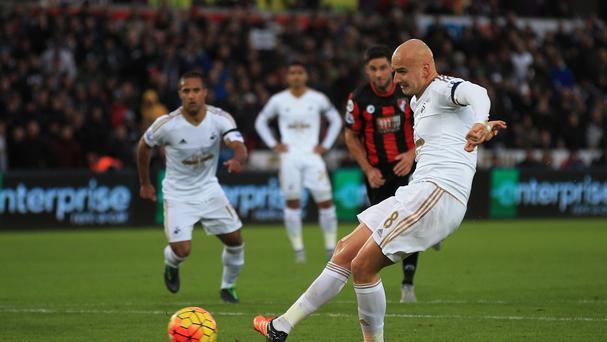 Swansea's Jonjo Shelvey equalised with a contentious penalty in their 2-2 Barclays Premier League home draw with Bournemouth.