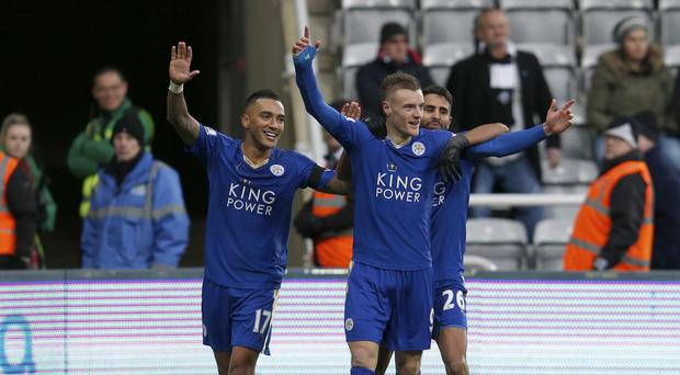 Jamie Vardy, centre, celebrates with his team-mates after scoring for the 10th game in a row