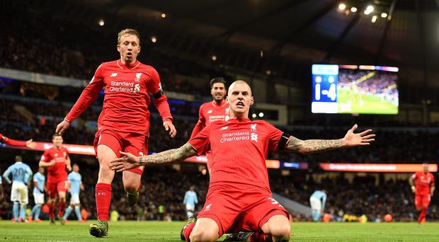 Liverpool's Martin Skrtel celebrates scoring his side's fourth goal of the game against Manchester City