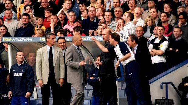 Claudio Ranieri, pictured left in cream suit jacket, gets a telling off from Liverpool assistant Phil Thompson on October 1, 2000
