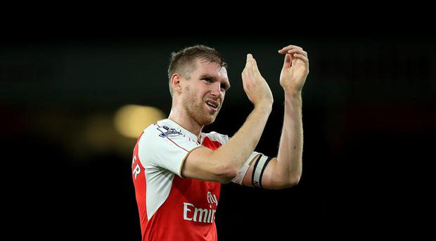 Arsenal's Per Mertesacker believes his side can get through to the Champions League knockout stages