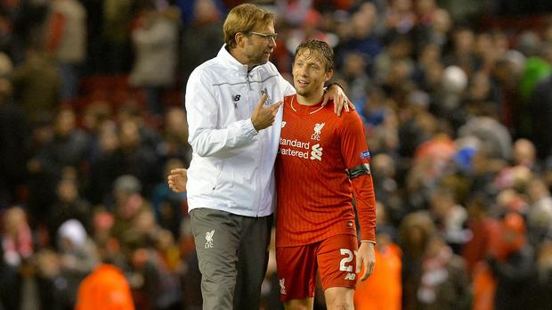 Jurgen Klopp, left, has hailed the contribution of Lucas Leiva, right