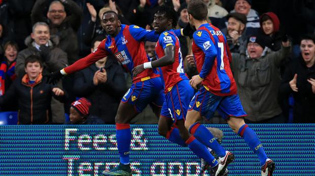 Yannick Bolasie, pictured left, notched twice as Crystal Palace routed Newcastle