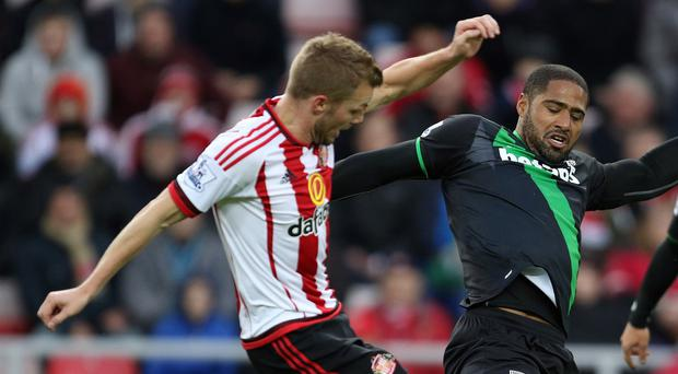 Sunderland midfielder Sebastian Larsson is keeping his feet firmly on the ground
