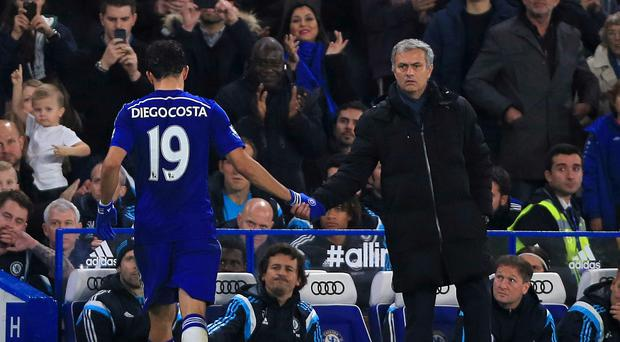 Chelsea striker Diego Costa (left) has been pictured on a squad night out which had the full blessing of manager Jose Mourinho (right)