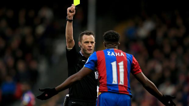 Crystal Palace's Wilfried Zaha was booked for diving against Newcastle