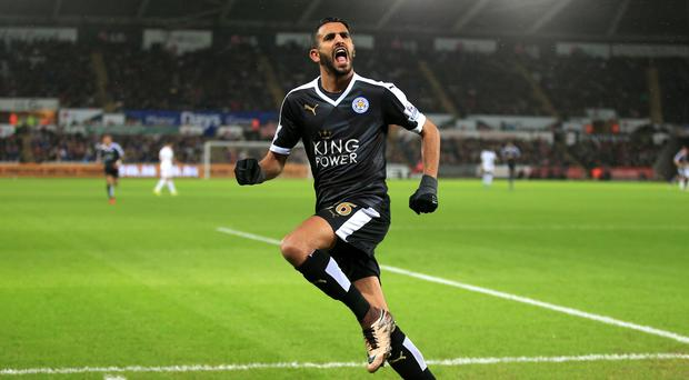 Leicester's Riyad Mahrez celebrates his hat-trick in their 3-0 Barclays Premier League win at Swansea