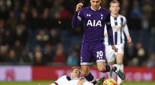 Tottenham's Dele Alli skips away from Jonny Evans in the 1-1 draw at West Brom.