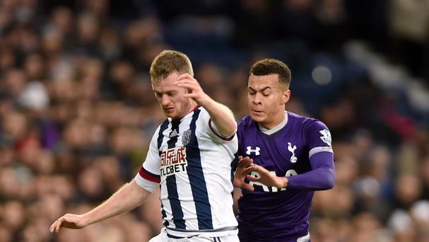 Tottenham goalscorer Dele Alli battles for the ball with West Brom's Chris Brunt in the 1-1 draw at The Hawthorns.