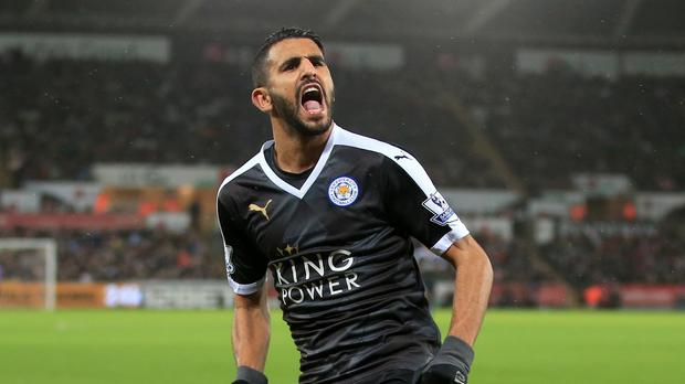 Riyad Mahrez scored a hat-trick in Leicester's 3-0 win at Swansea as the Foxes returned to top spot in the Barclays Premier League.