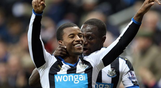 Georginio Wijnaldum celebrates scoring his side's second goal