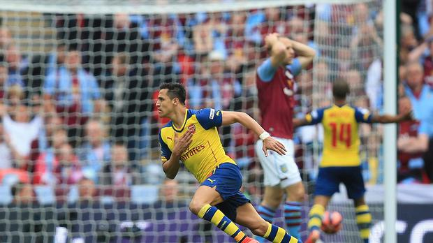 Alexis Sanchez scored 20 goals in 2015, including a wonder-strike in the FA Cup final