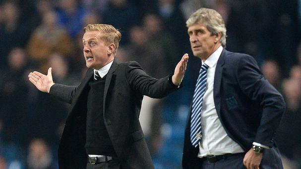 Manchester City boss Manuel Pellegrini (right) has spoken in defence of sacked Swansea counterpart Garry Monk (left)