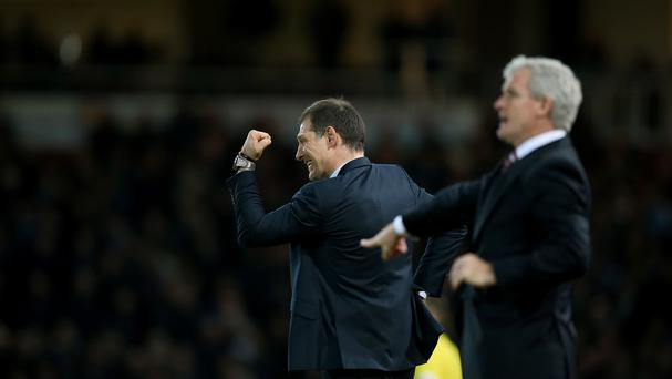 Slaven Bilic (left) and Mark Hughes saw their teams play out an entertaining goalless draw