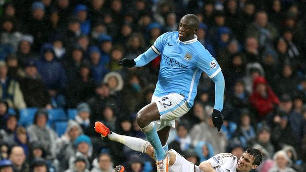 Yaya Toure helped Manchester City to a late win over Swansea