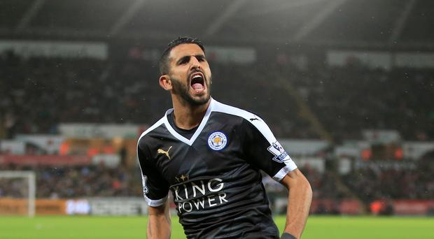 Leicester's Riyad Mahrez celebrates his hat-trick in the 3-0 win at Swansea.