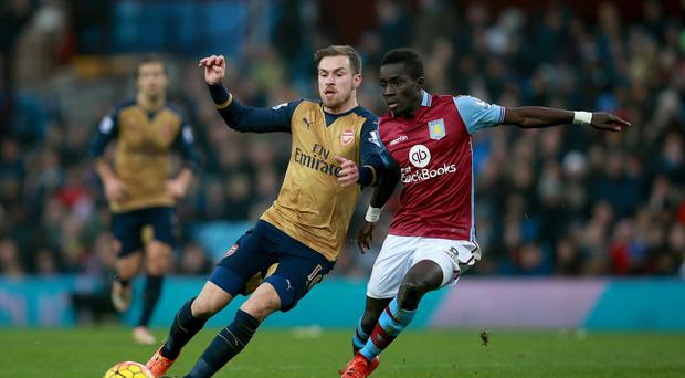 Arsenal's Aaron Ramsey, battling with Aston Villa's Idrissa Gana, scored the Gunners' second in their 2-0 win.