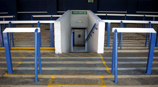 The Government will re-assess its ban on standing areas at Premier League grounds