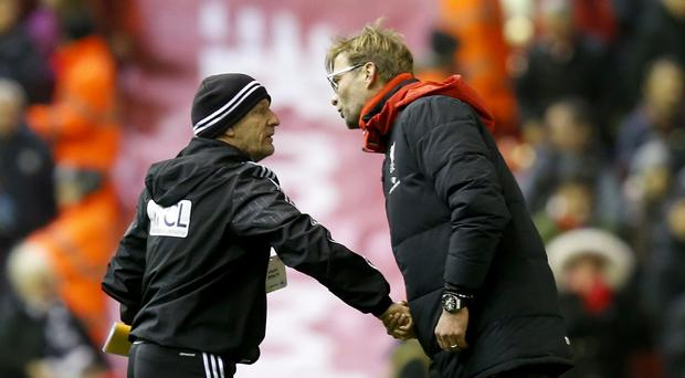 Liverpool manager Jurgen Klopp and West Brom coach Mark O'Connor share a handshake