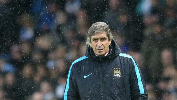 Manuel Pellegrini, pictured, is not concerned about Pep Guardiola rumours at Manchester City