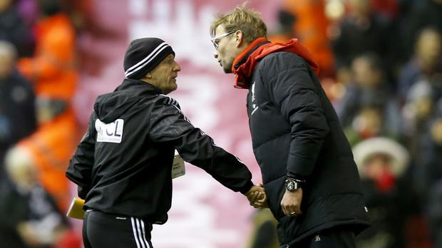 Jurgen Klopp, right, shook hands with West Brom coach Mark O'Connor but not boss Tony Pulis
